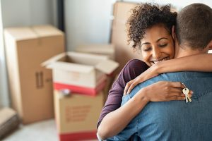 man-and-woman moving into home